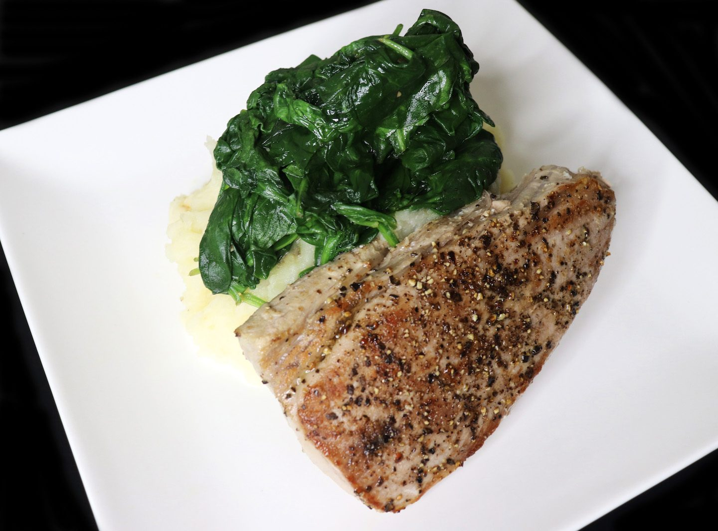 Pepper Tuna Steak, Roasted Garlic Mashed Potatoes and Sauteed Spinach