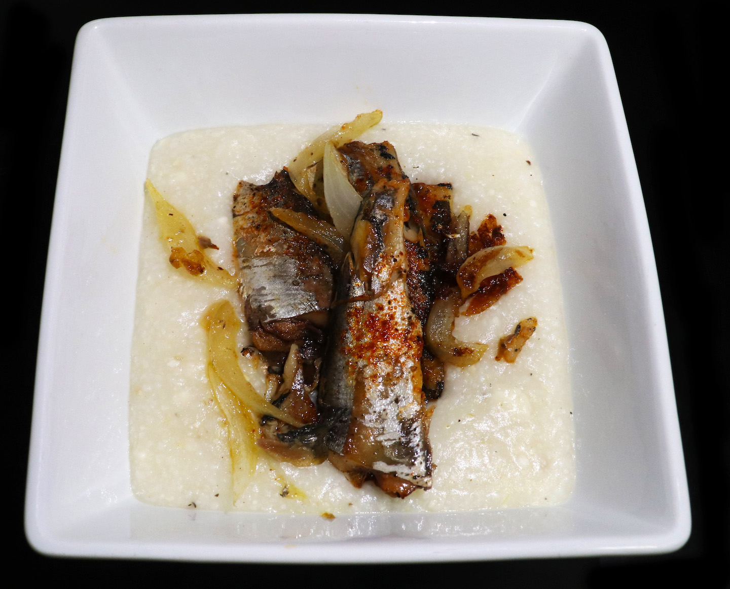 Sardines and Cheddar Grits with Caramelized Onion